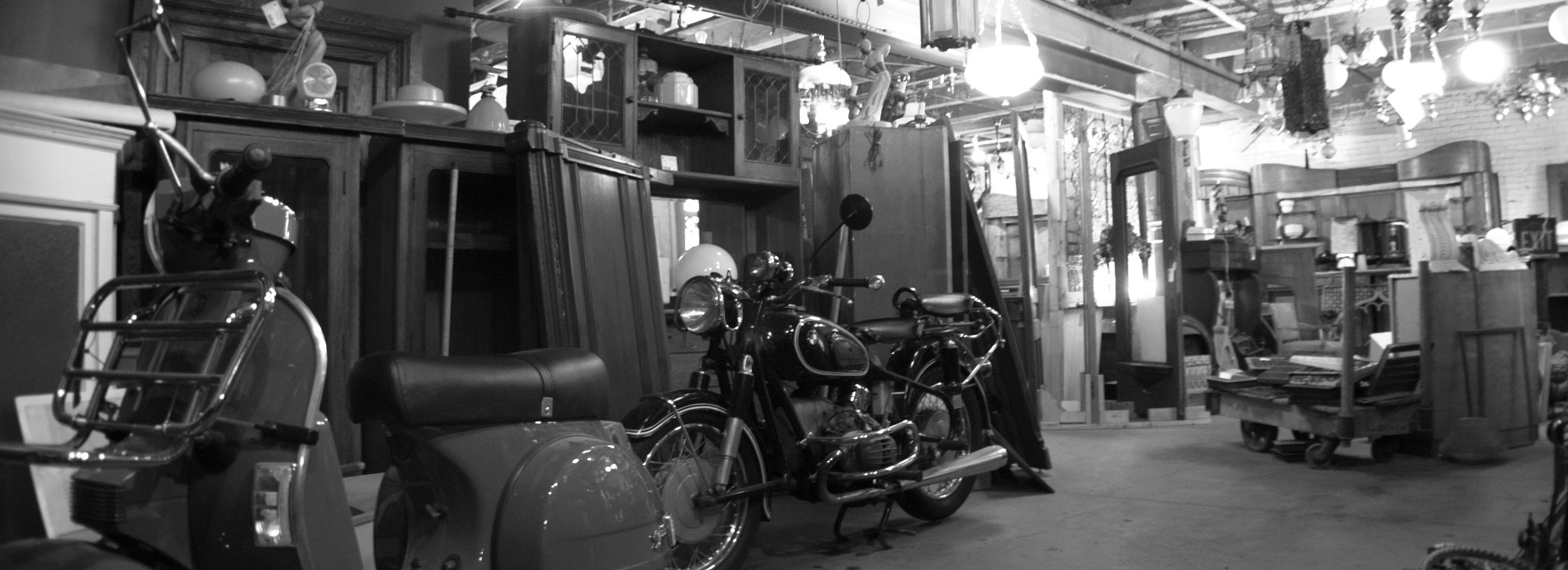 City Salvage showroom—vintage scooter and motorcycle.